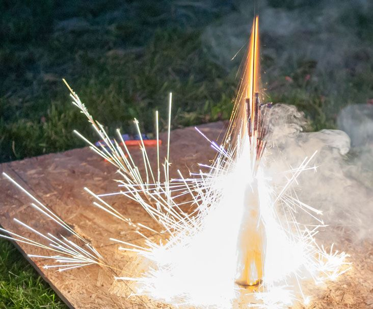 Multiple Bottle Rockets Firing from Glass